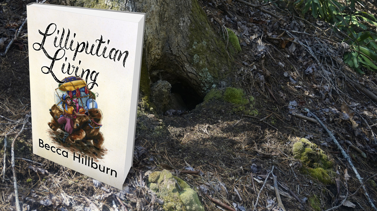 Lilliputian Living Compendium book in the woods.